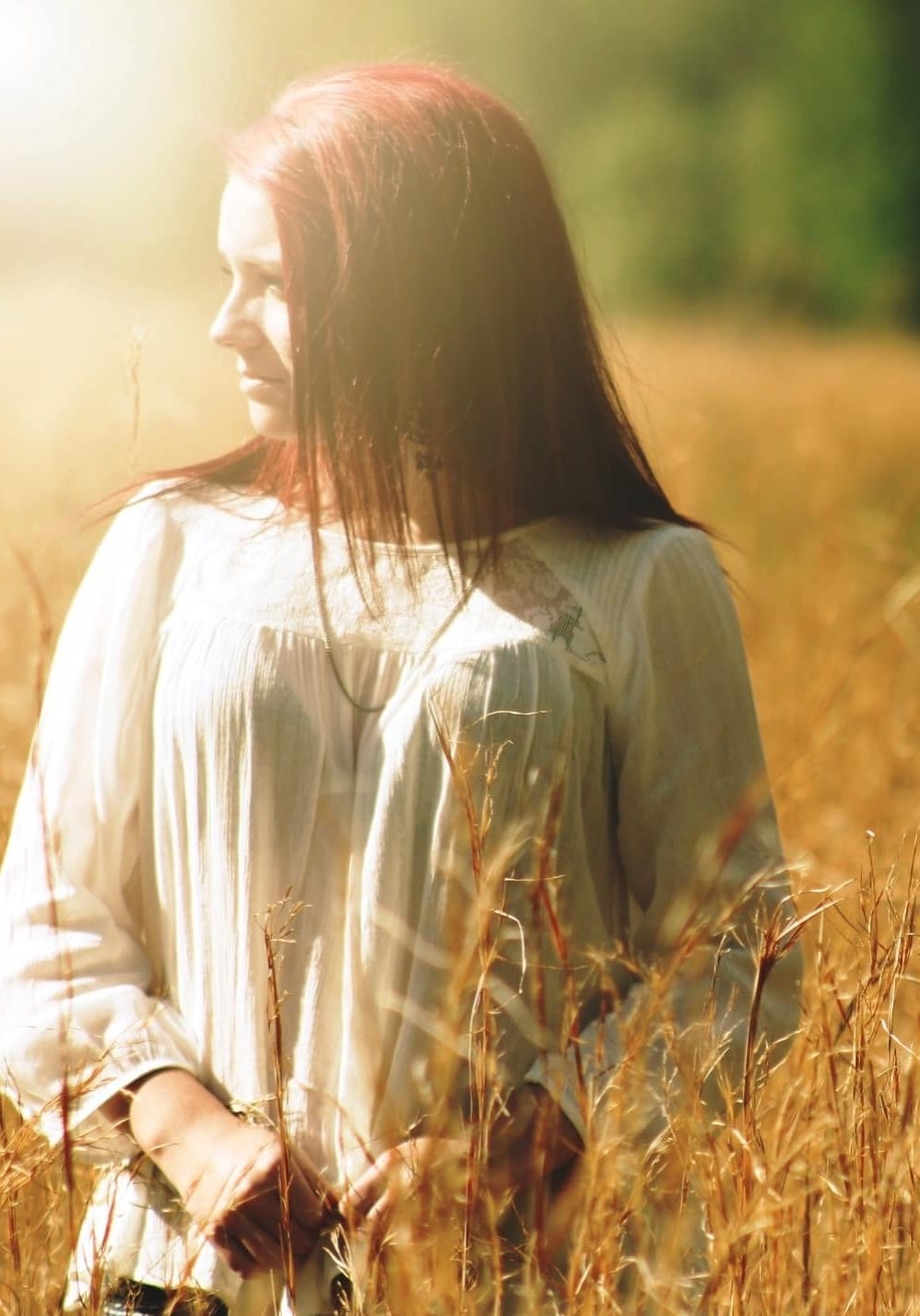 Canva - Woman Wearing White Long Sleeved Shirt Standing in Brown Grass Field